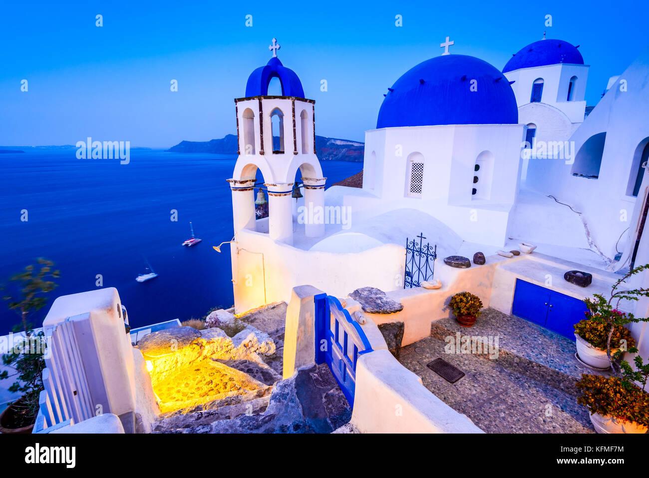Santorini, Greece. Oia white village with cobbled paths, greek orthodox blue church. - Stock Image