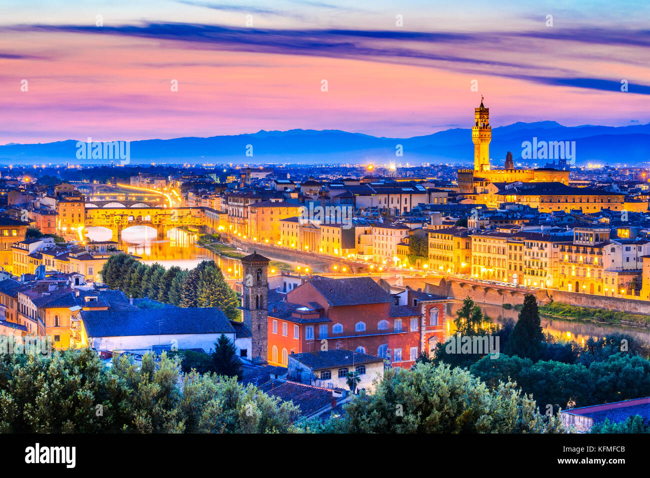 Florence, Tuscany - Night scenery Arno River and Palazzo Vecchio, Renaissance architecture in Italy. - Stock Image