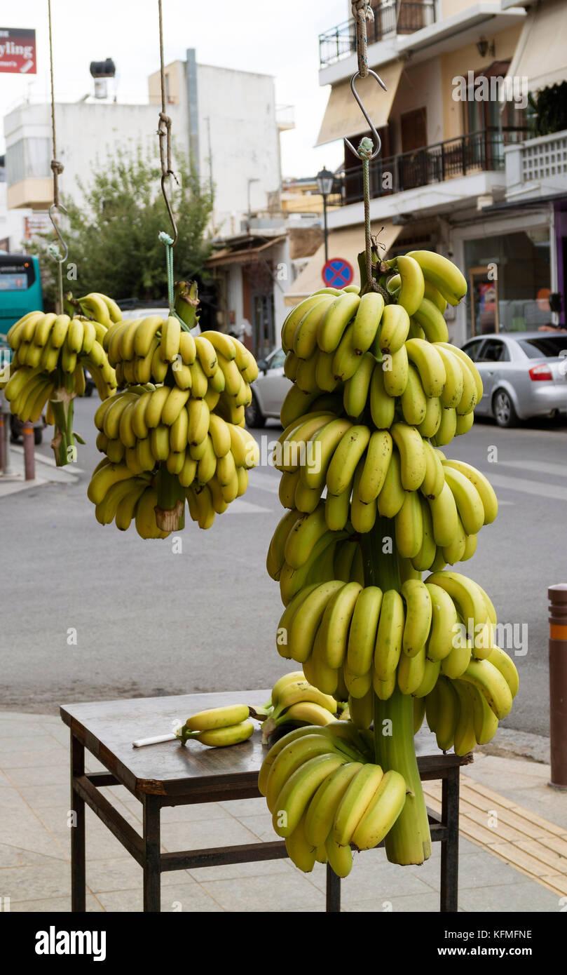 Malia, Crete, Greece. Local grown bananas on sale in the main street, - Stock Image