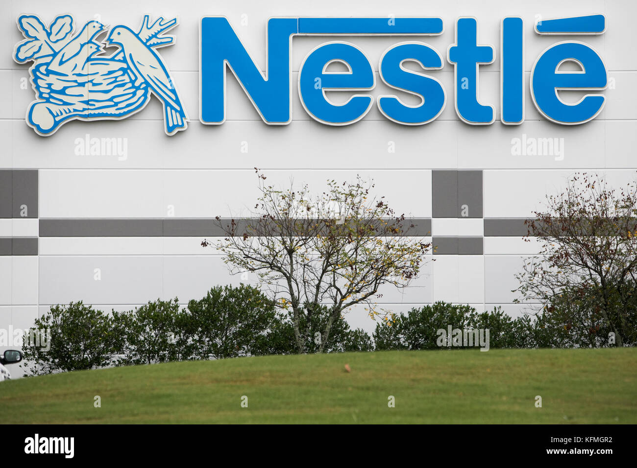 A logo sign outside of a facility occupied by Nestle in McDonough, Georgia on October 8, 2017. - Stock Image