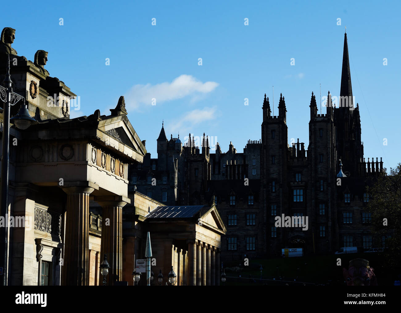 The RSA building caught in the sunlight and the General Assembly halls on the mound in shadow.  Edinburgh - Stock Image
