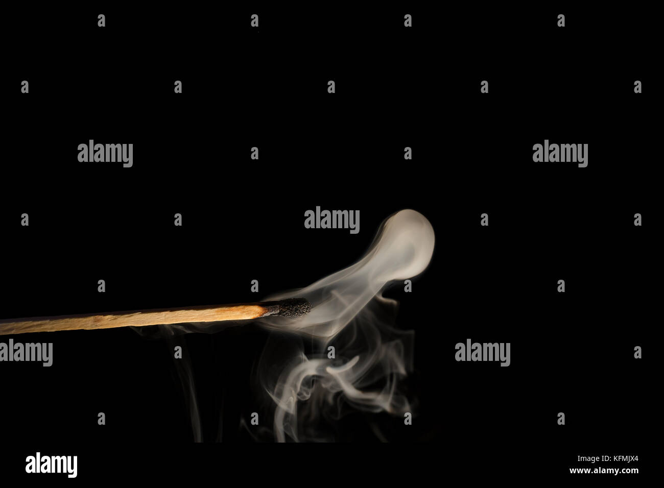 Match photographed close up with black background. - Stock Image