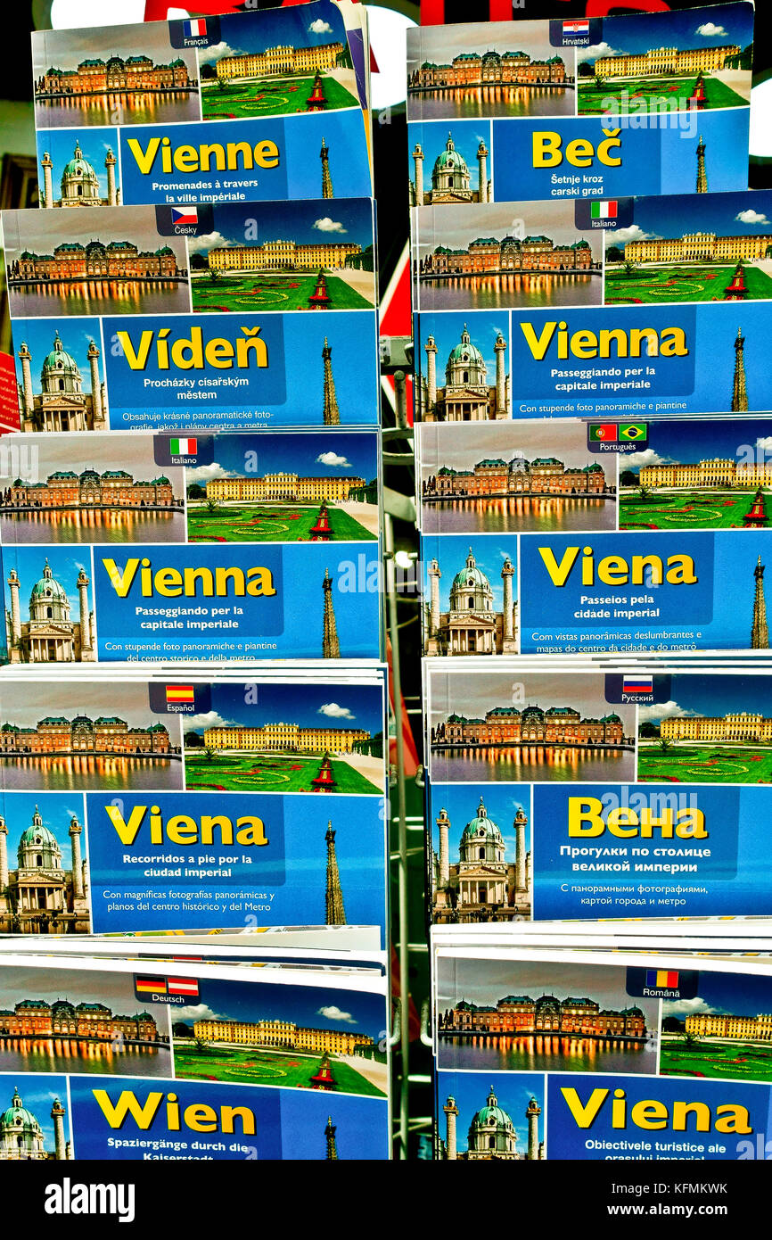 City guide books with Viennese motifs, multilingual tourist guide books, on display on a rack, outside a souvenir - Stock Image