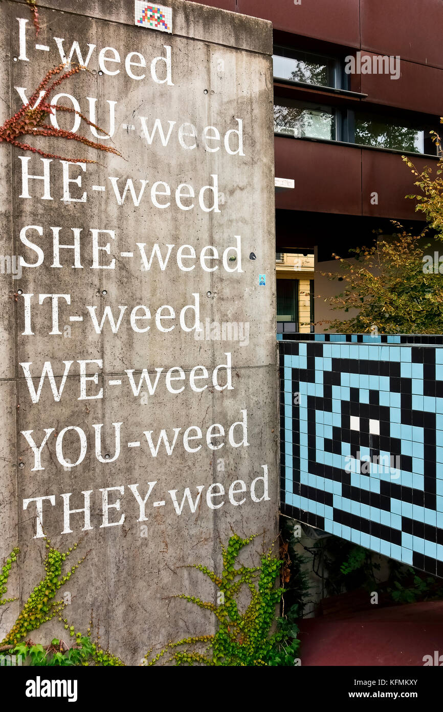 Street Art Passage Vienna at the MuseumsQuartier. Exhibition venue in public space. Blue, black tiles wall. Weed - Stock Image