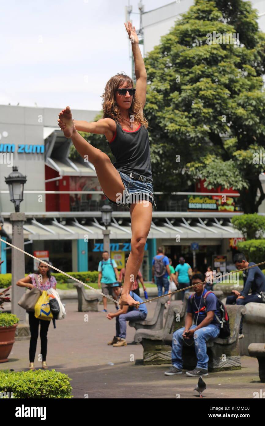 Tightrope walker entertains passers-by, Parque Central, San José, San José province, Central Highlands, - Stock Image