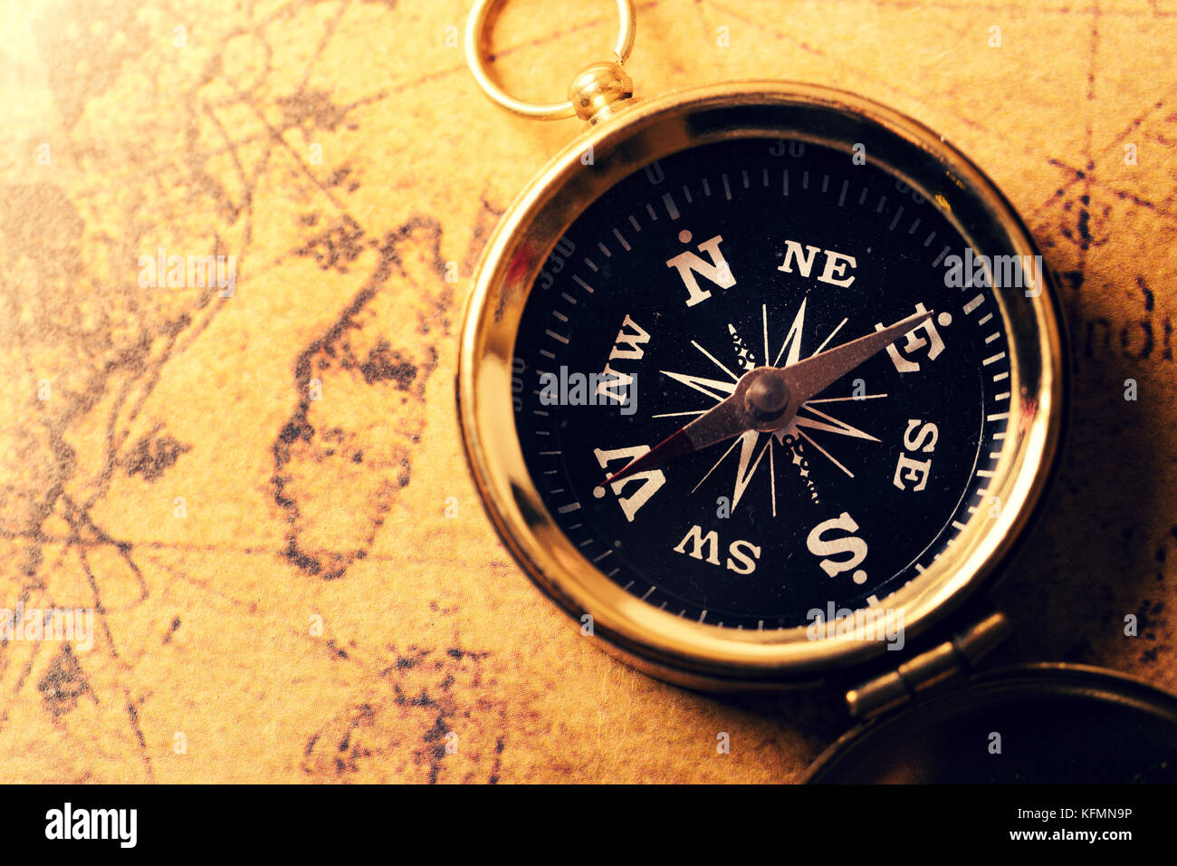 golden compass on old treasure map - Stock Image