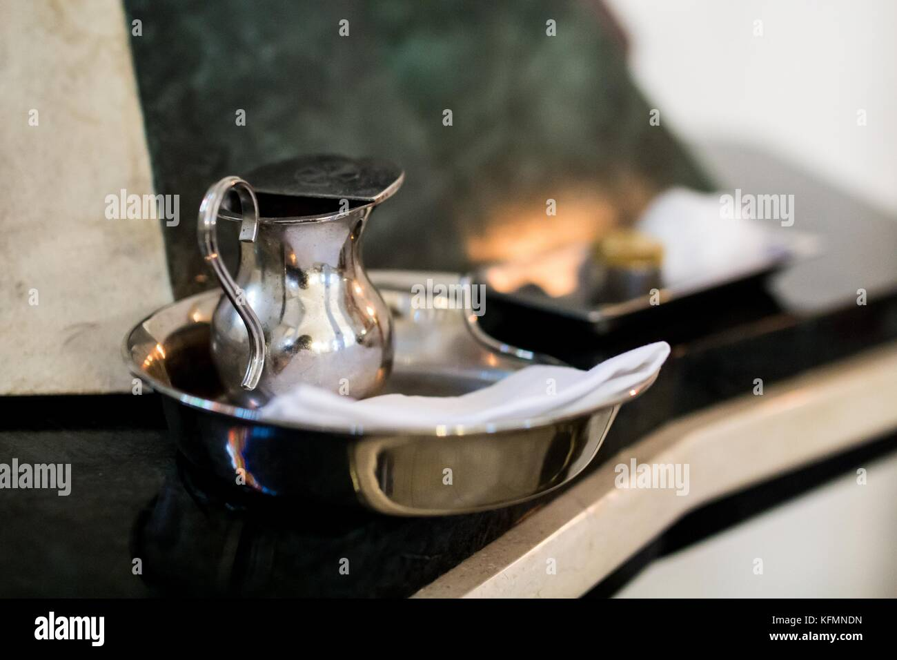 liturgical vessels for christening - baptismal font and jug - Stock Image