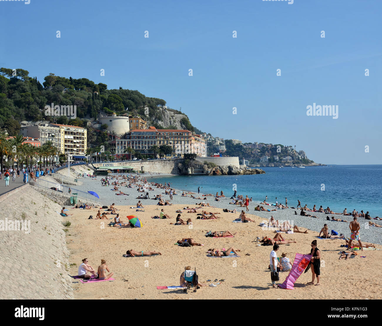 Nice, France - September 27, 2017: People on the Beach and Promenade at Nice, France - Stock Image