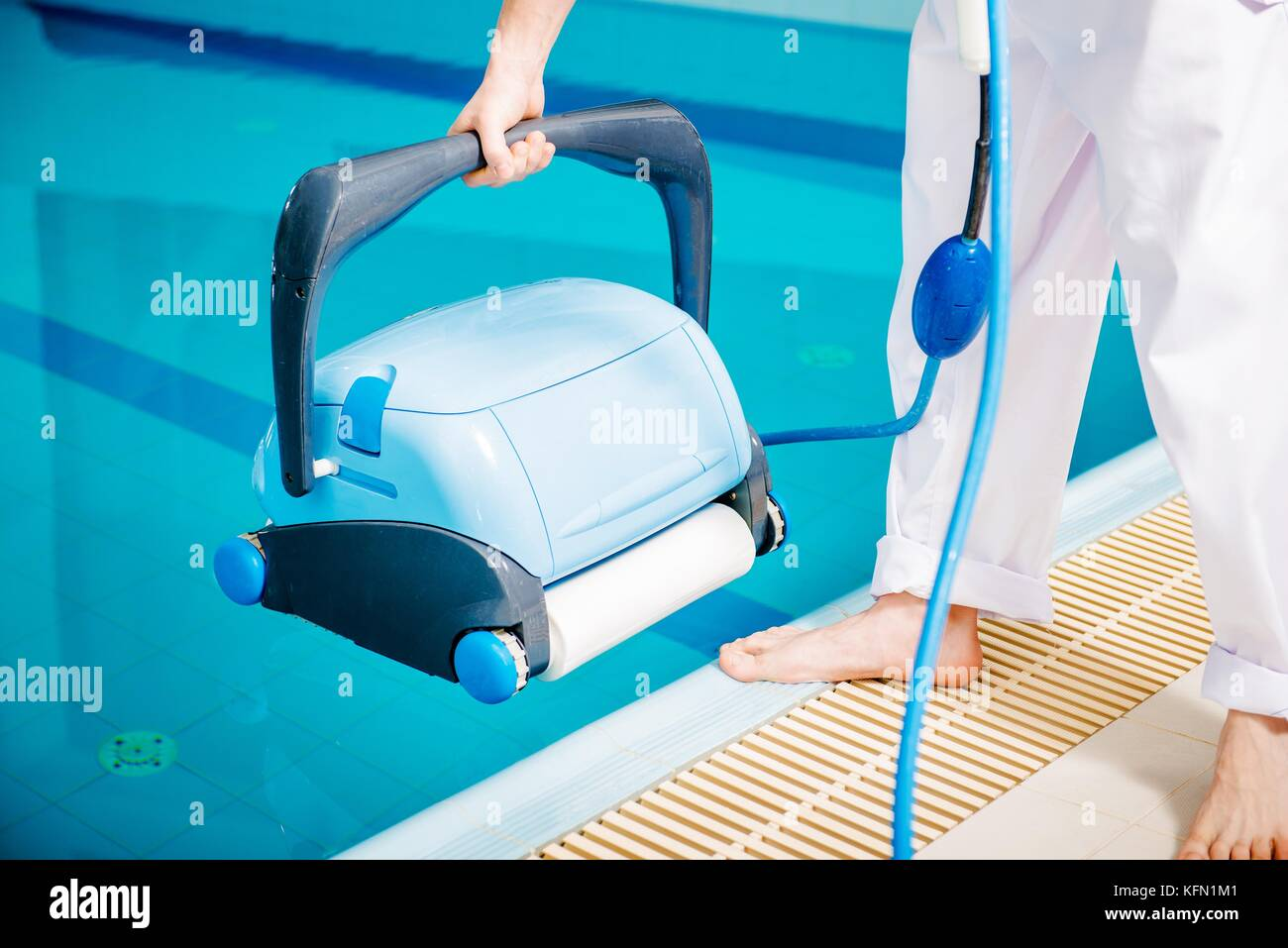 Swimming pool cleaner pool cleaning machine and the caucasian stock photo 164575489 alamy for Swimming pool cleaning machine