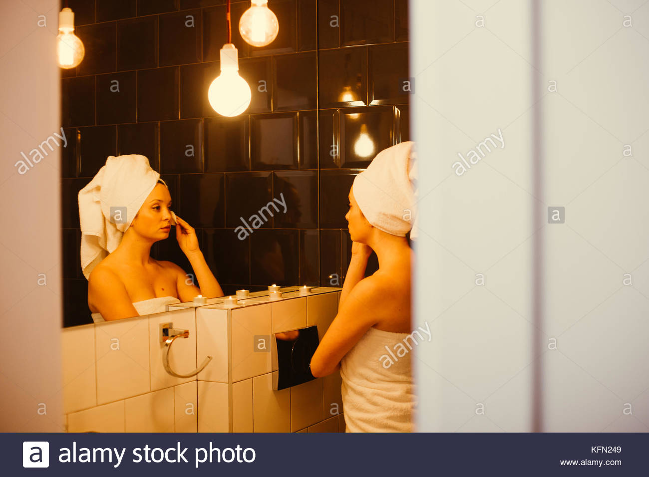 Young women doing her evening makeup routine - Stock Image