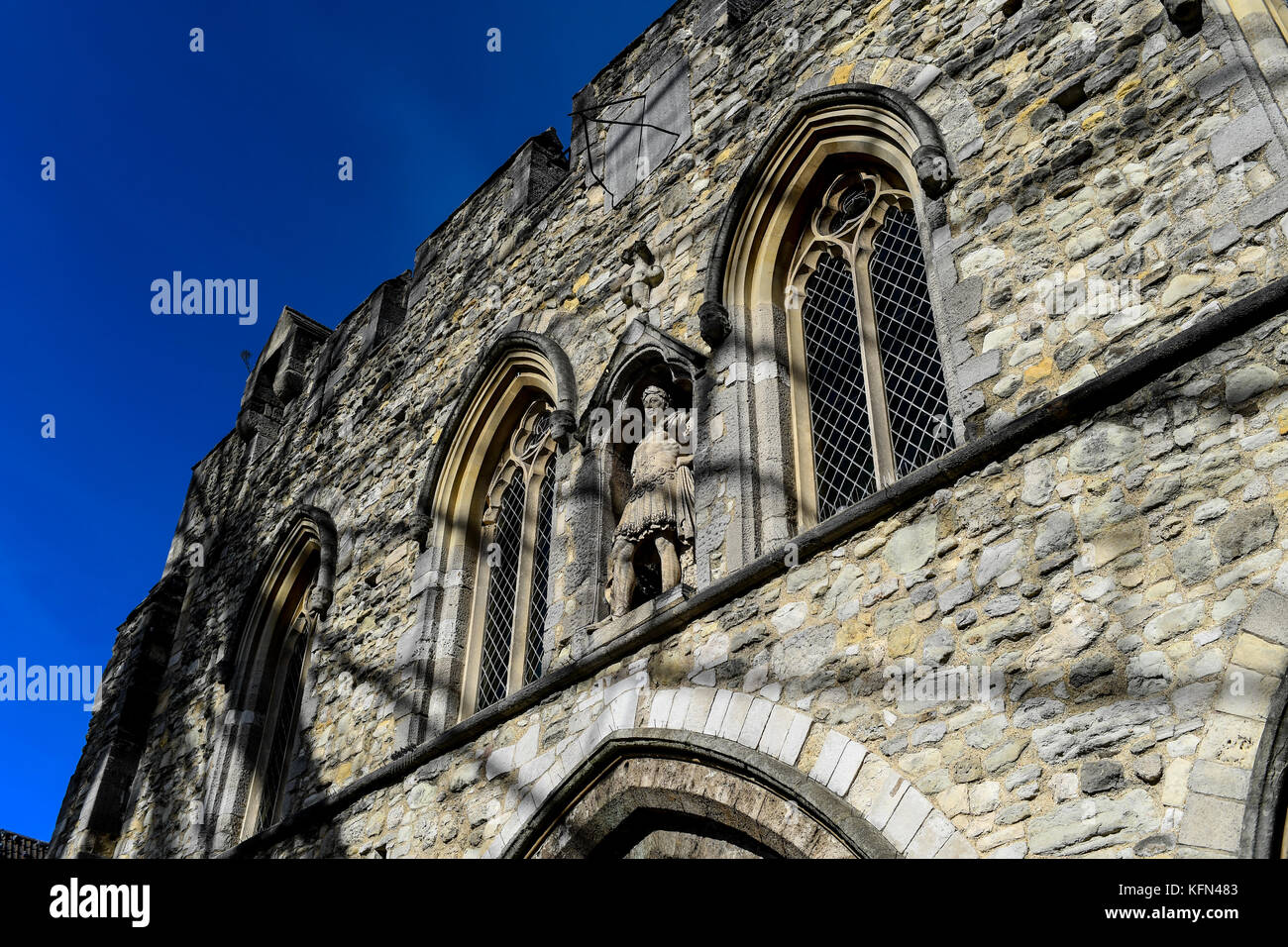 The Bargate in Southampton with the shadows of a near by ferris wheel across the stone work.The Bargate is a medieval Stock Photo
