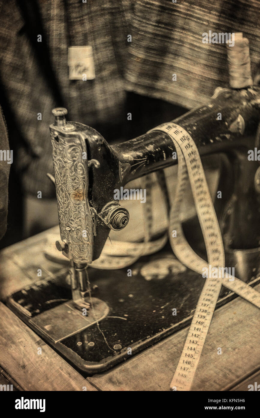 Antique Sewing Machine, shot with very old Vintage Lens, weathered textured Photograph, in Sepia Tones - Stock Image