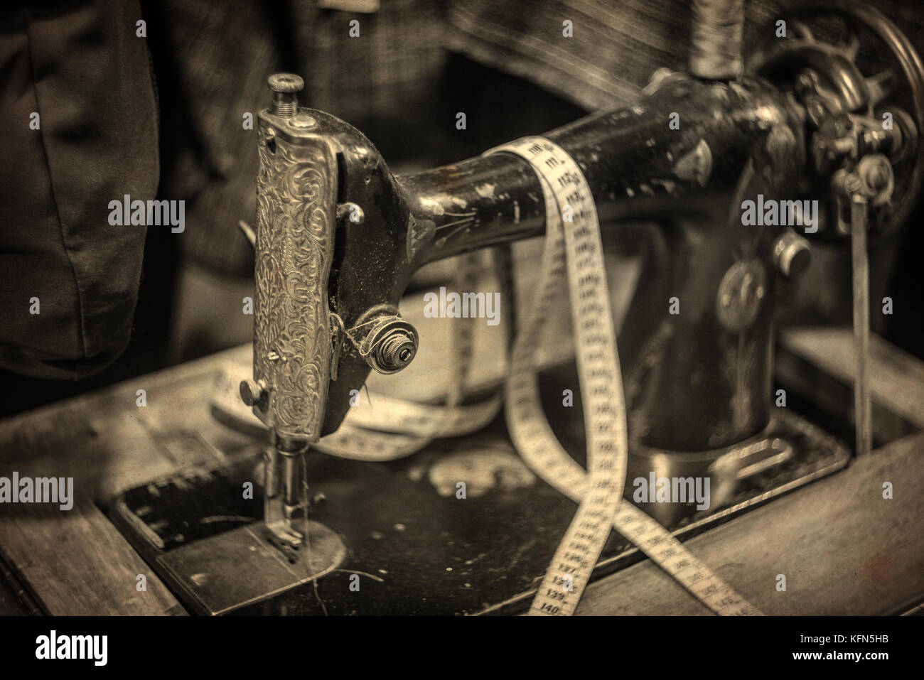 Antique Sewing Machine, shot with very old Vintage Lens, weathered textured Photograph, in Sepia Tones Stock Photo