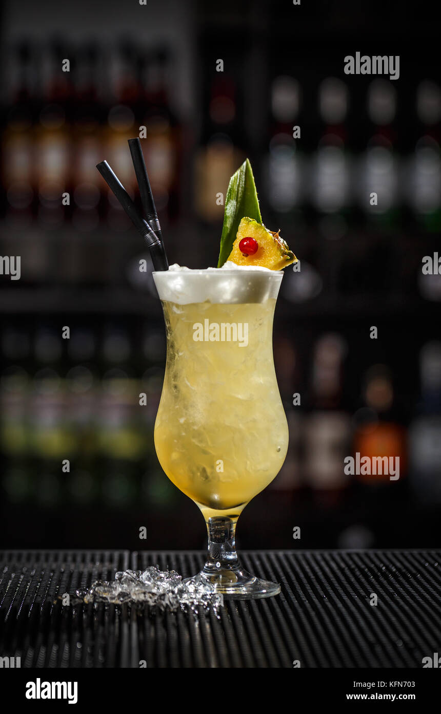 Pina colada cocktail on a bar counter - Stock Image