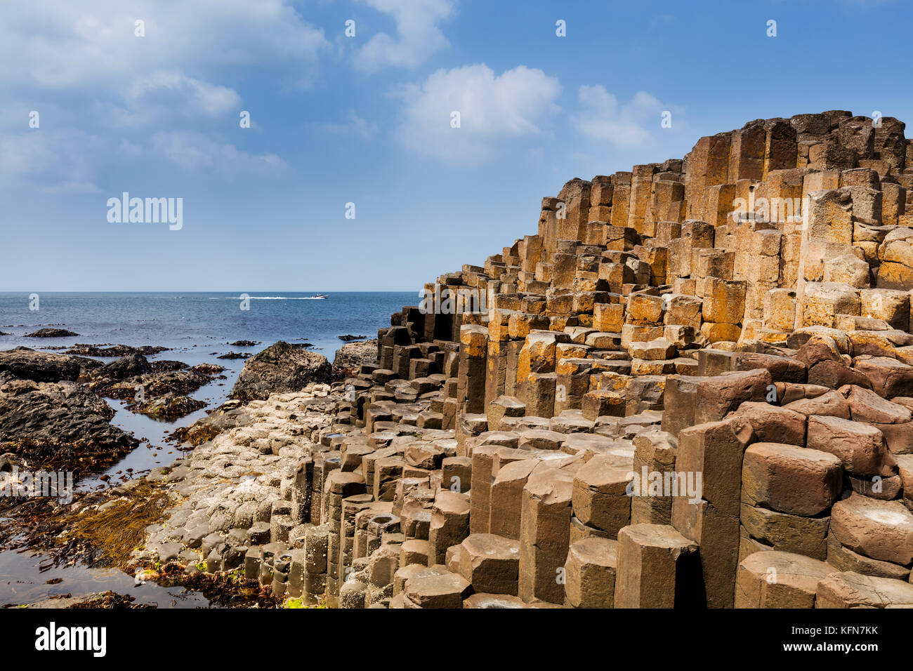 The Giants Causeway in County Antrim of Northern Ireland is declared a World Heritage Site by UNESCO containing - Stock Image