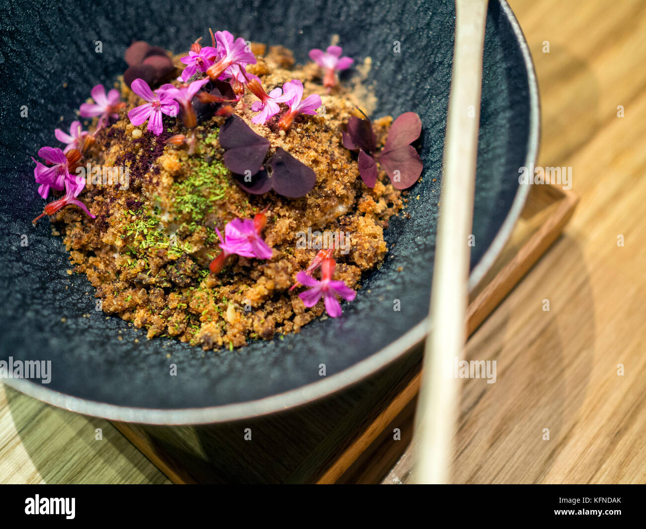 Fried sourdough bread with leek and ham cooked by Pai Holmberg from Bifångst, a two seat restaurant in Gothenberg. - Stock Image