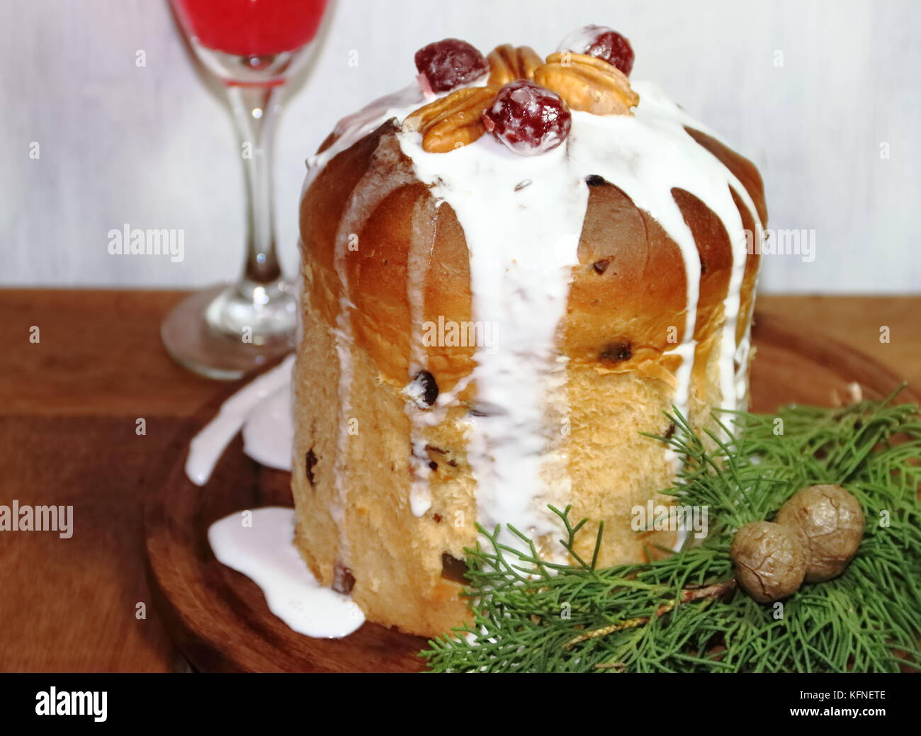 sweet bread Christmas pudding cin dried and glazed fruits and sparkling beverages - Stock Image