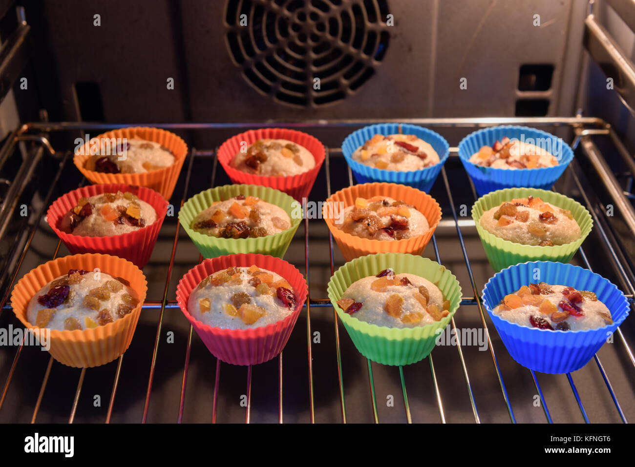 Homemade colorful cupcakes in baker - Stock Image