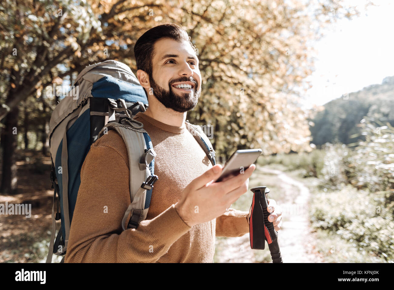 Handsome man having a walk outdoors - Stock Image