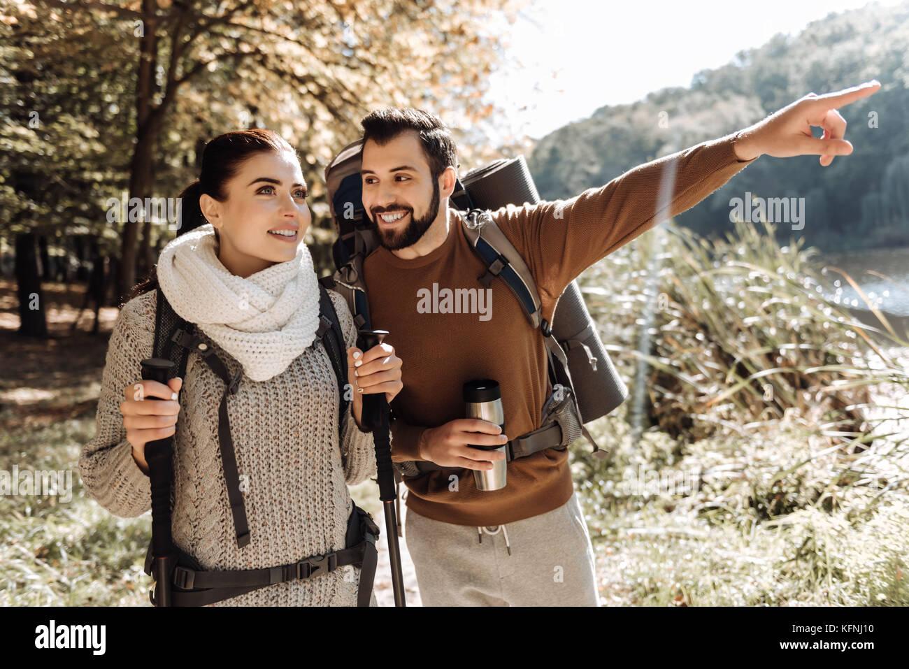 Lovely couple having romantic nature trip - Stock Image
