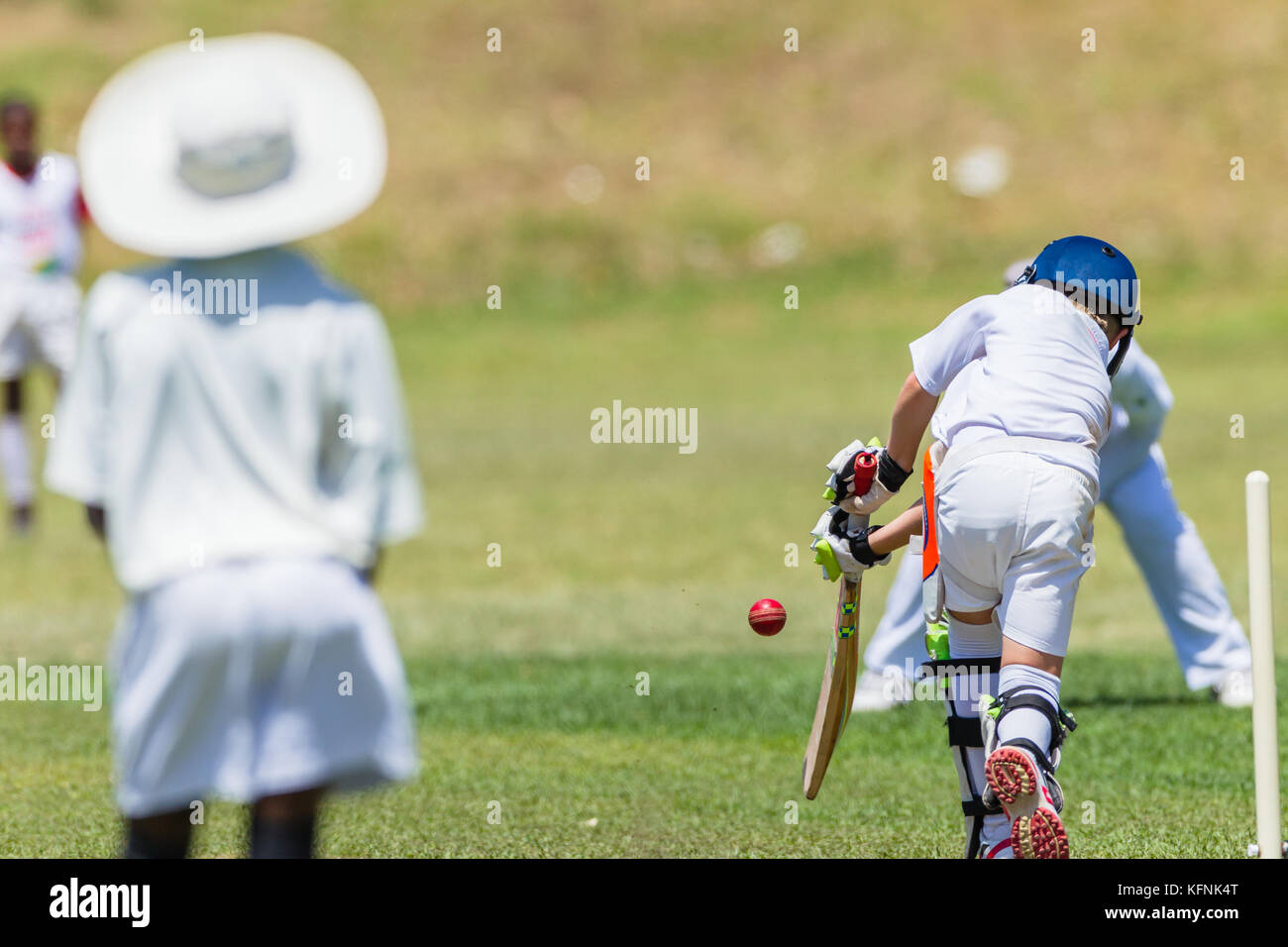 Cricket game juniors players Fielder Batsman unidentified action abstract. - Stock Image