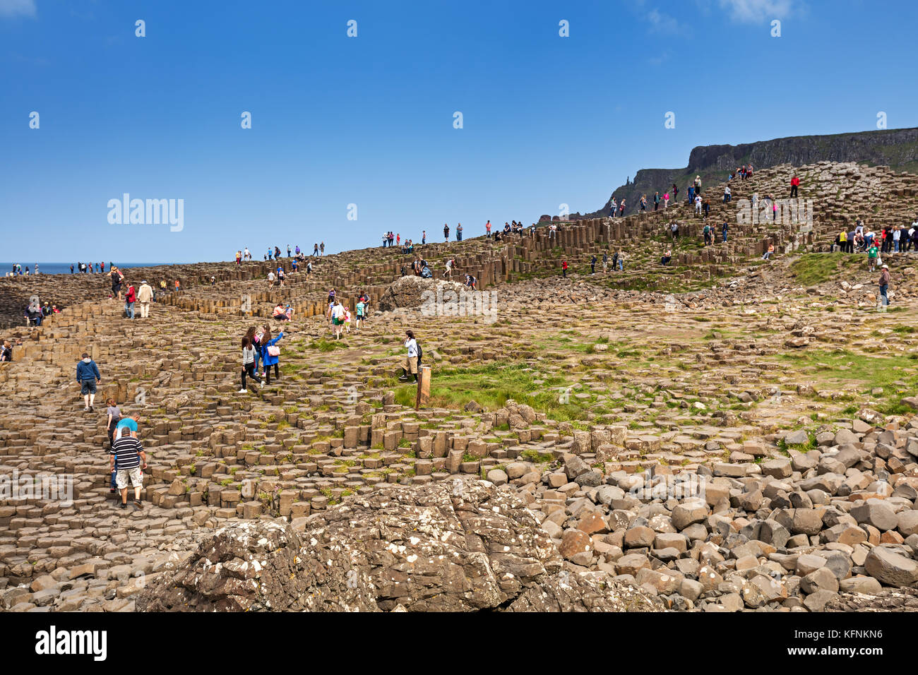Thousands of tourists visiting Giant's Causeway in County Antrim of Northern Ireland, a World Heritage Site - Stock Image