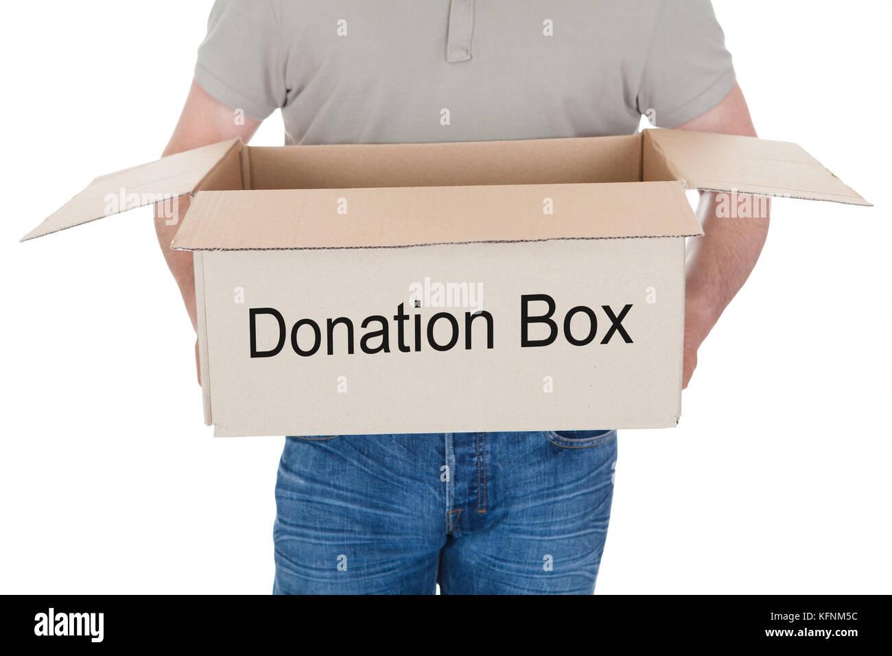 Man holding donation box isolated on white background - Stock Image