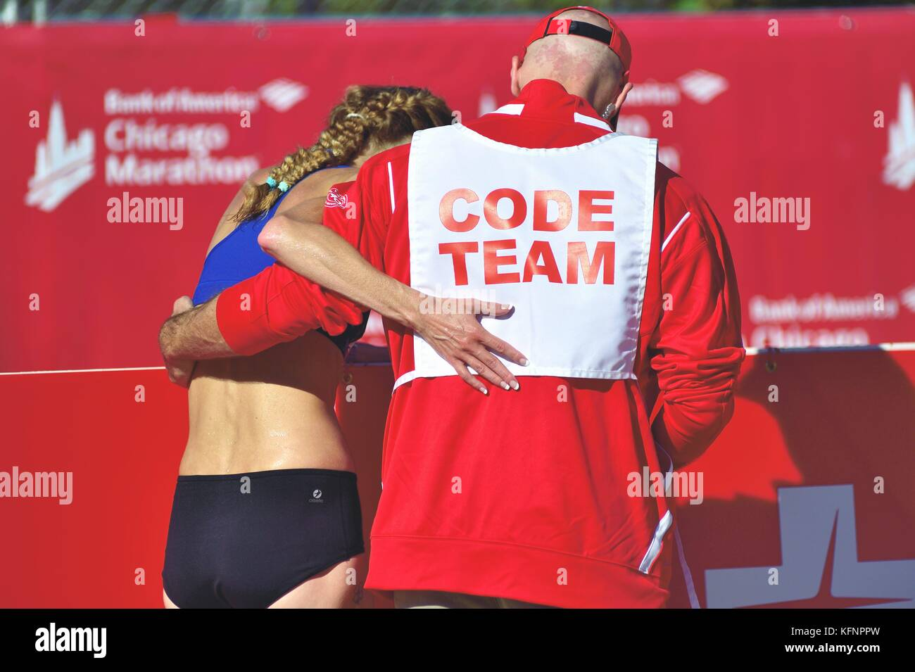 Just after crossing the finish line at the 2017 Chicago Marathon, a competitor needed assistance to leave the course. - Stock Image