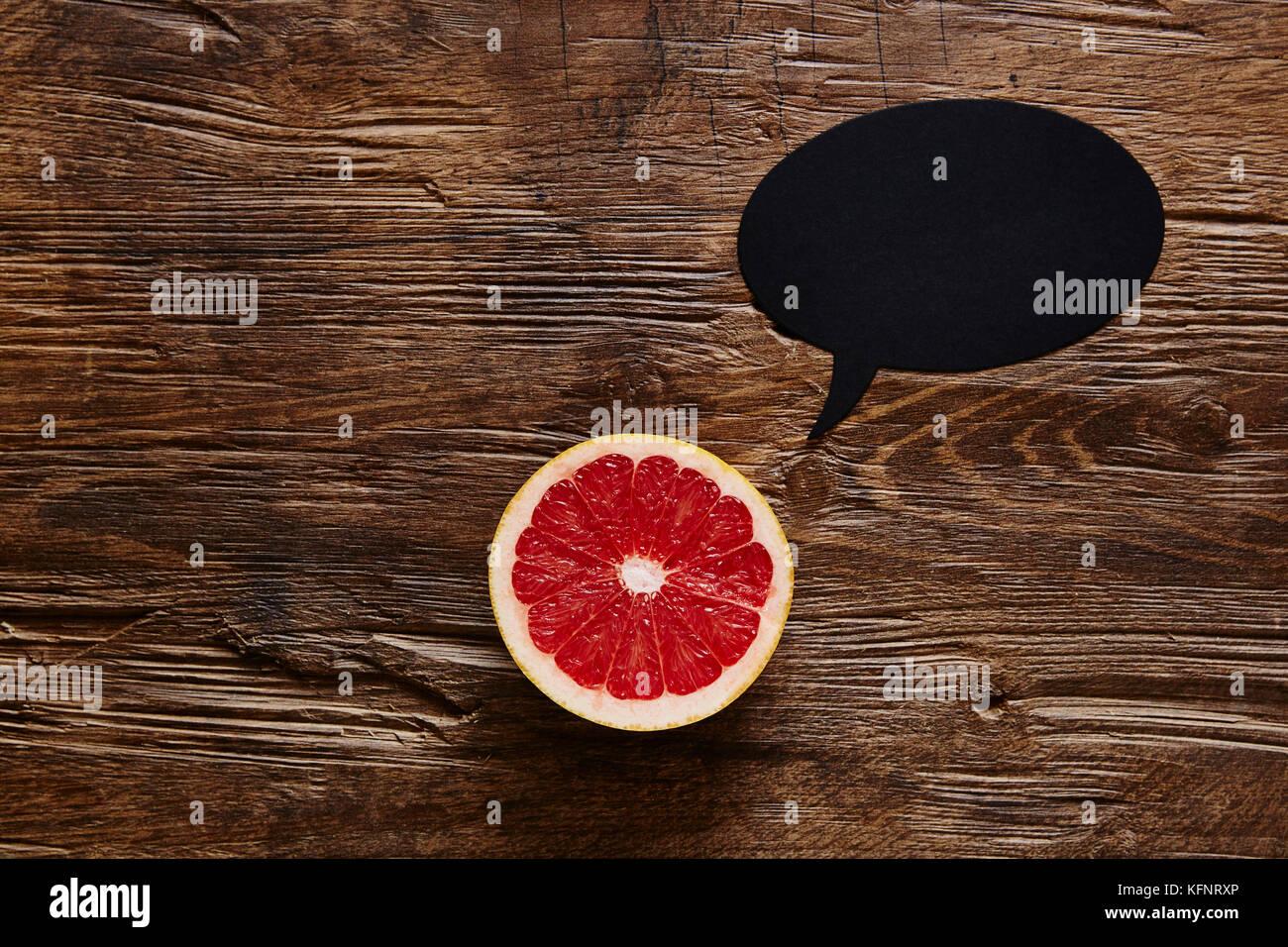 sliced grapefruit has something to say - Stock Image