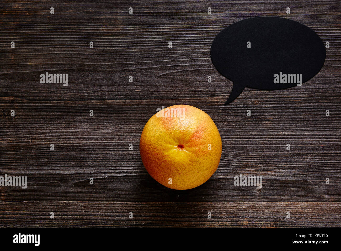 grapefruit with speechbubble has something to say - Stock Image