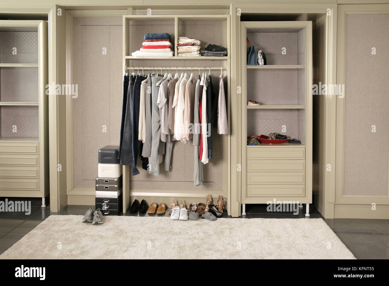 Some Wardrobe Hanging Or Put On The Shelf In The Open Closet Room