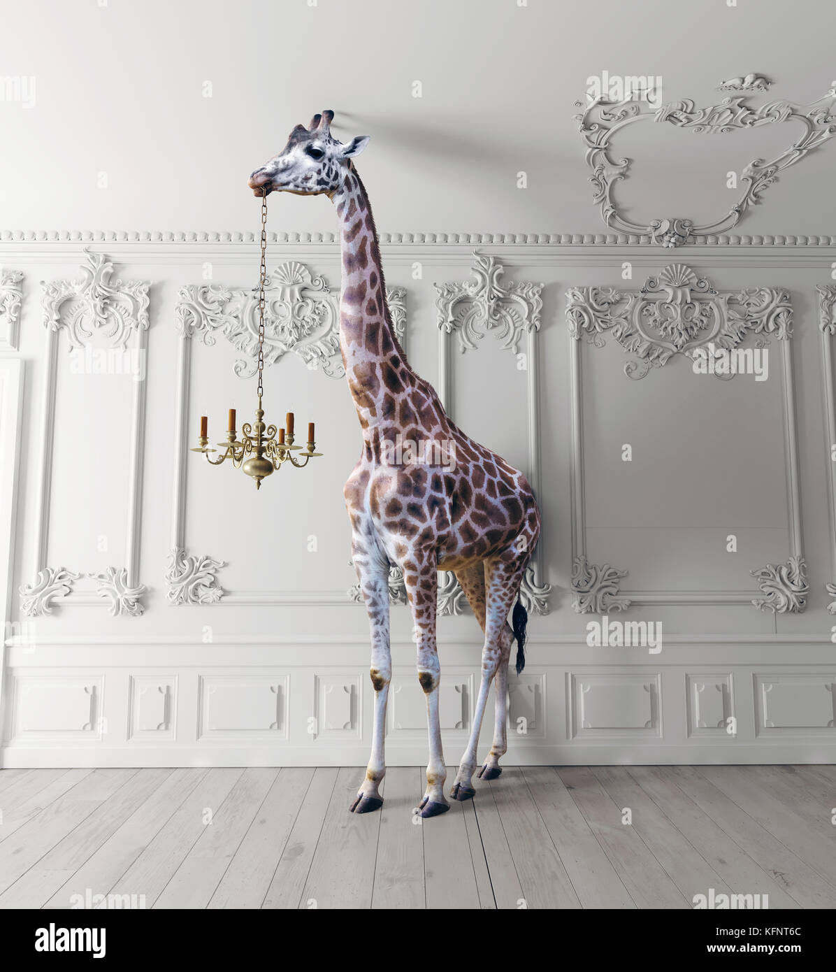 the giraffe hold the chandelier in the luxury decorated interior - Stock Image