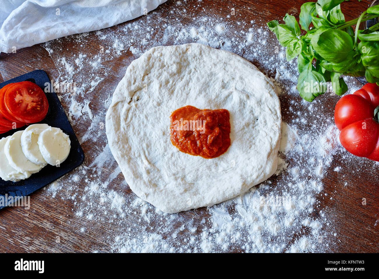 baking pizza rolled out dough no sauce - Stock Image