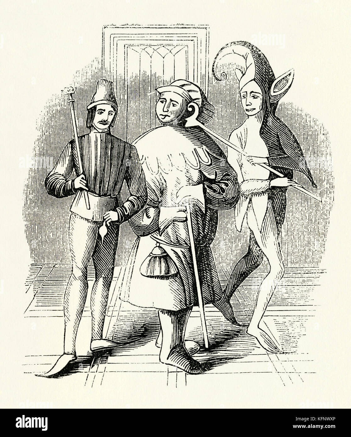 An old Medieval engraving of fools, buffoons, jesters (or court jesters). The fool was historically an entertainer - Stock Image