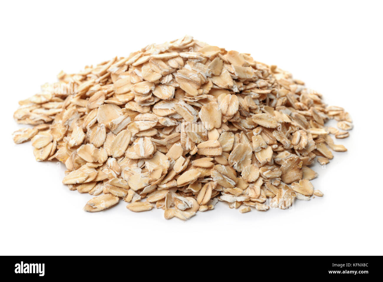 Pile of dry rolled oatmeal isolated on white - Stock Image
