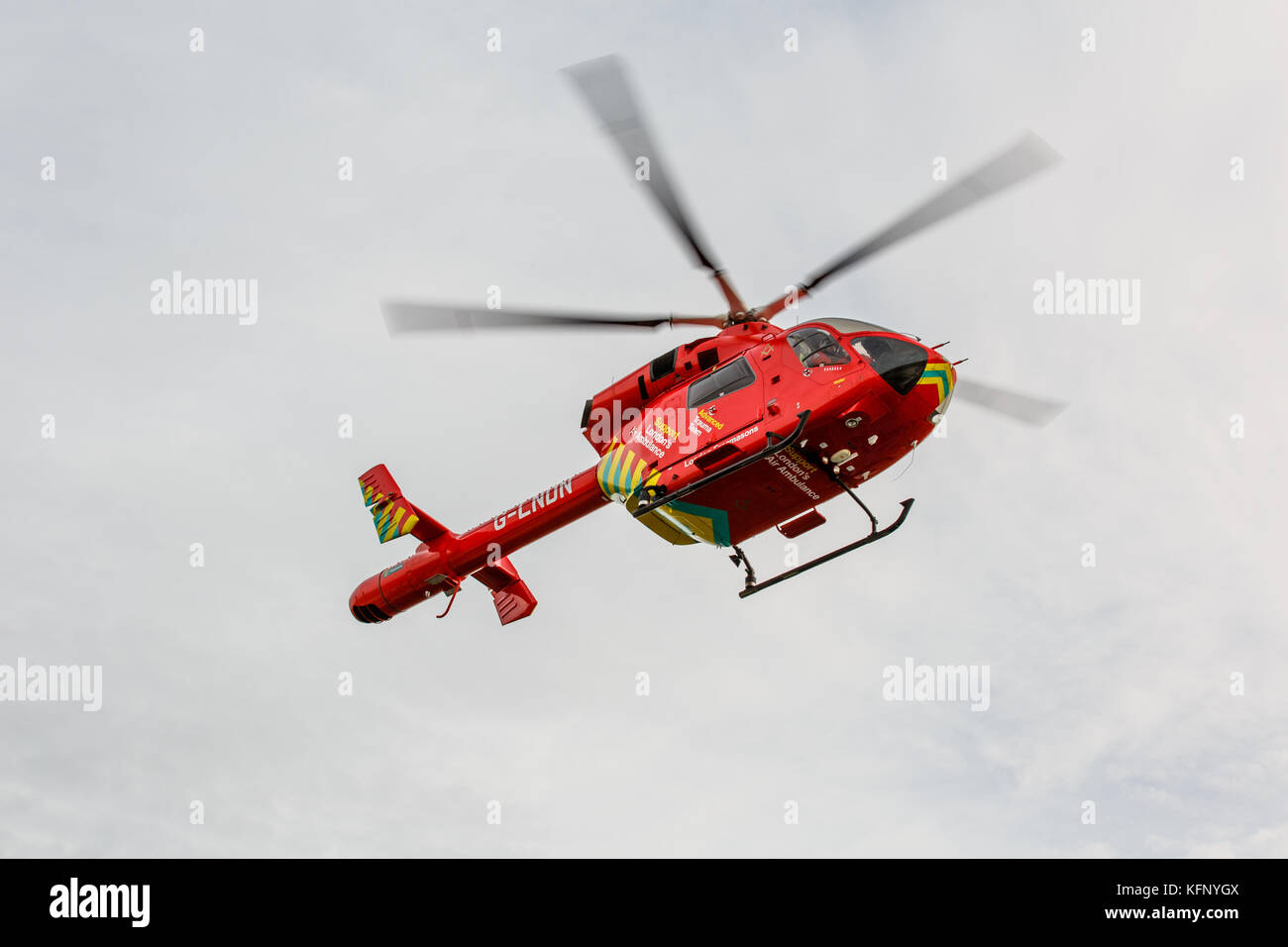 London Air Ambulance helicopter returning to helipad on the Royal London Hospital. - Stock Image