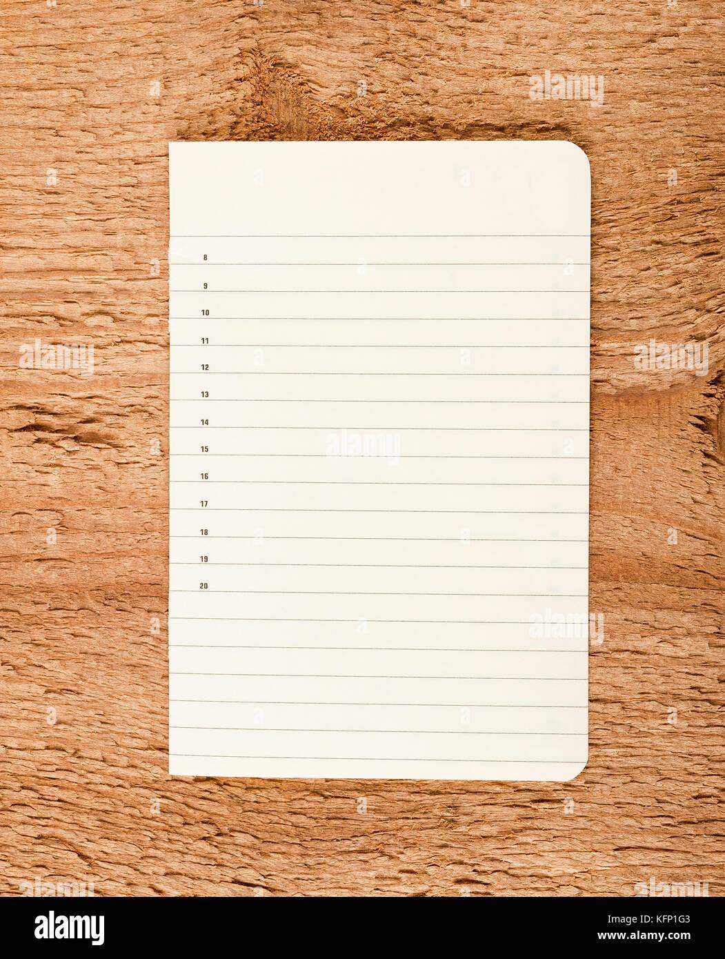 Paper sheet on wood background - Stock Image