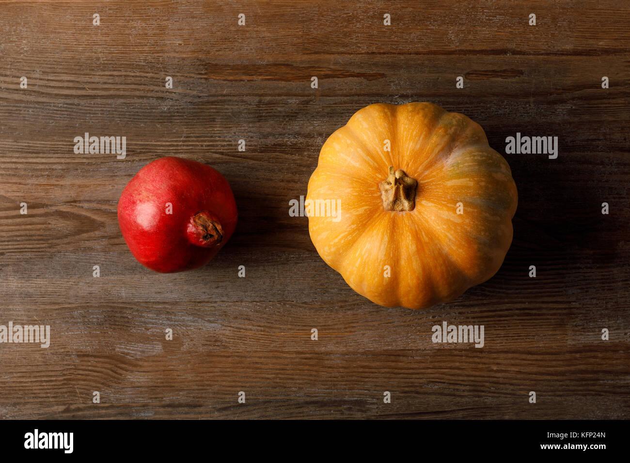 seasonal pomegranate and pumpkin - Stock Image