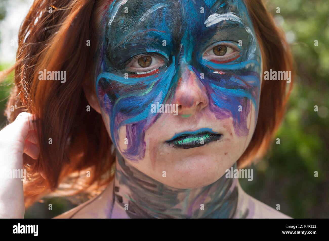 Girl with a painted face - Stock Image