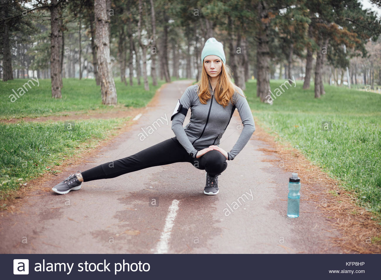 Young women exercise in park - Stock Image