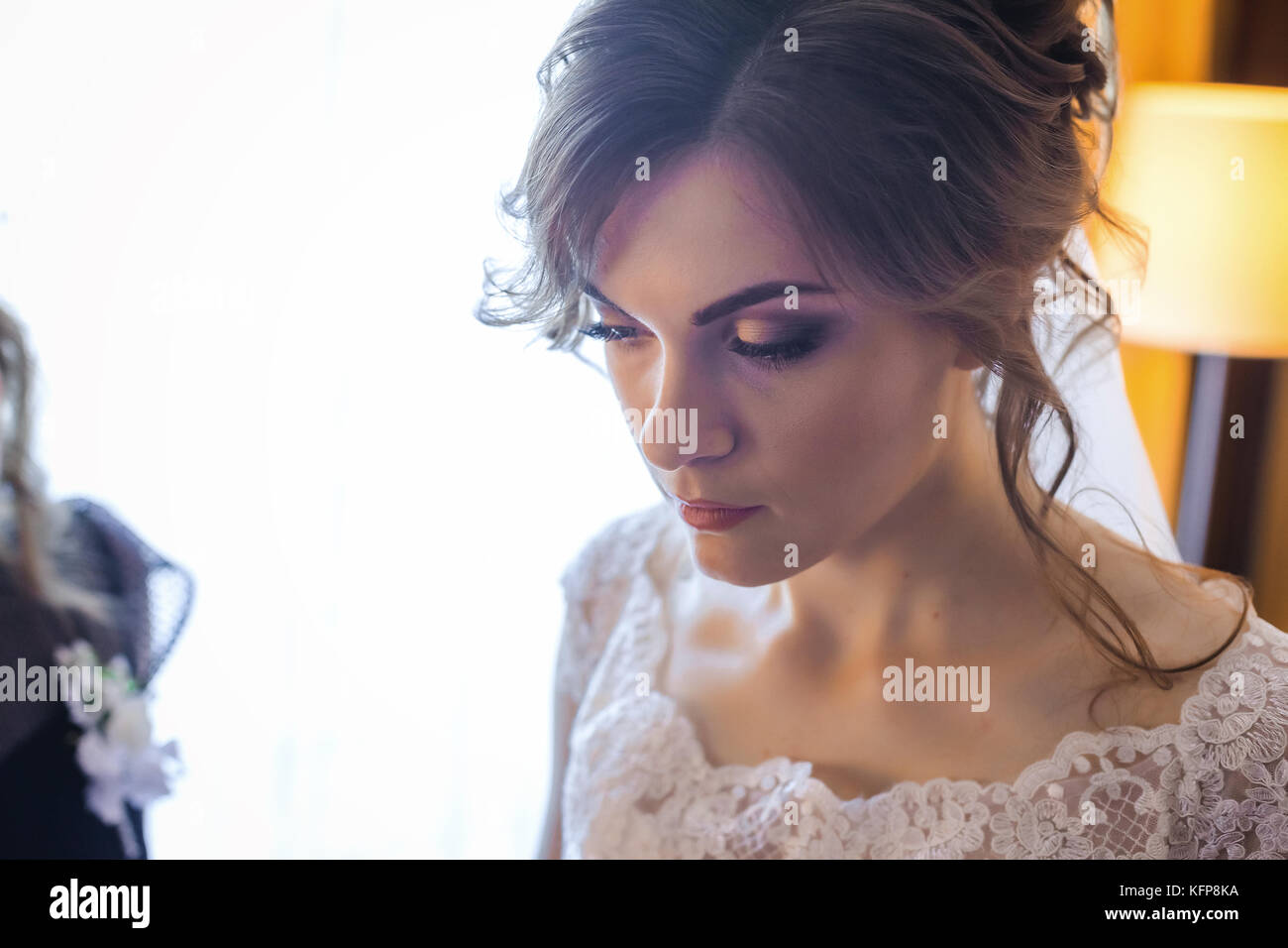 Thoughtfull bride looking for groom - Stock Image