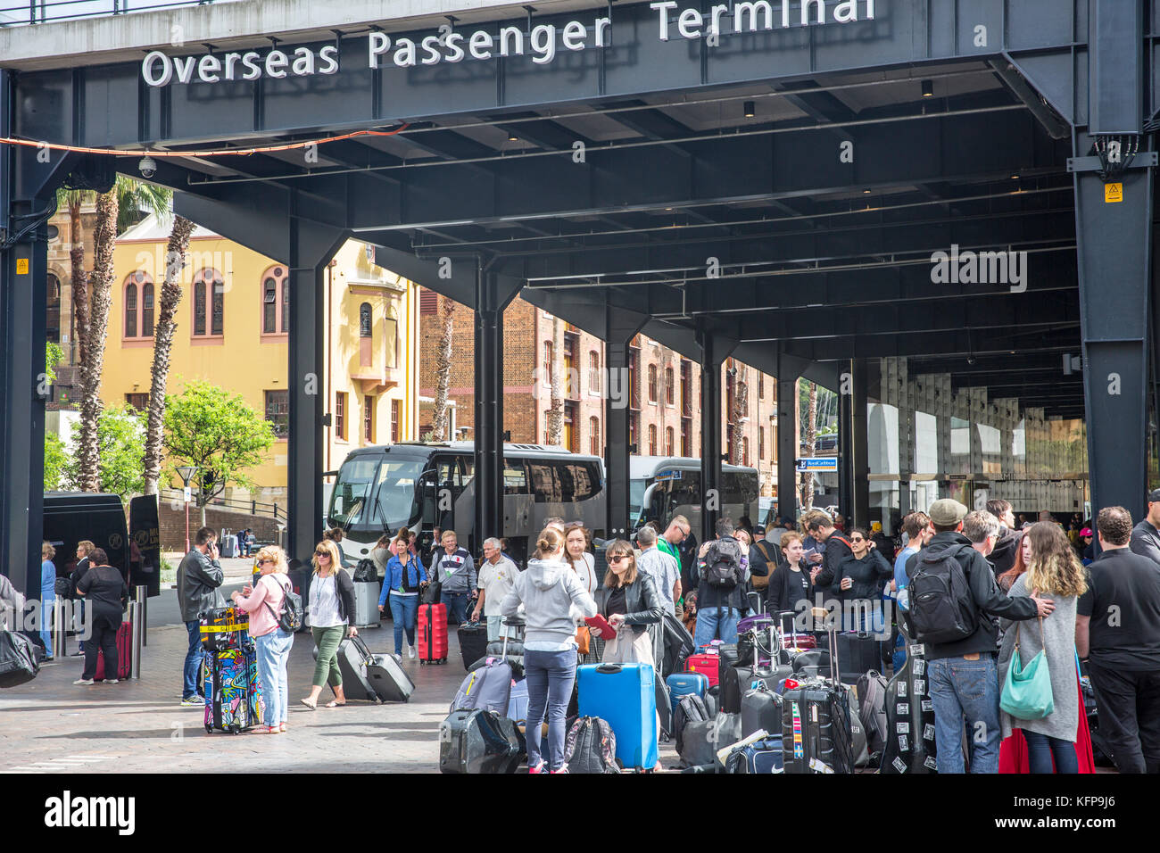 Passengers with luggage after disembarking a cruise ship at the Overseas Passenger Terminal in Sydney Circular Quay,Sydney,Australia - Stock Image