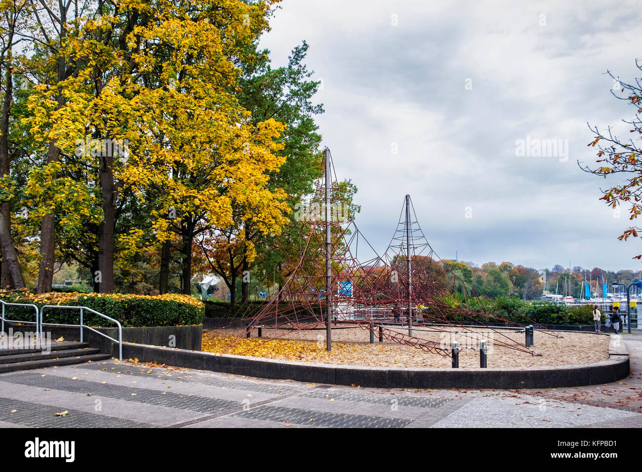 Berlin ,Wannsee harbour .Children's climbing frame and playground is deserted in Autumn - Stock Image