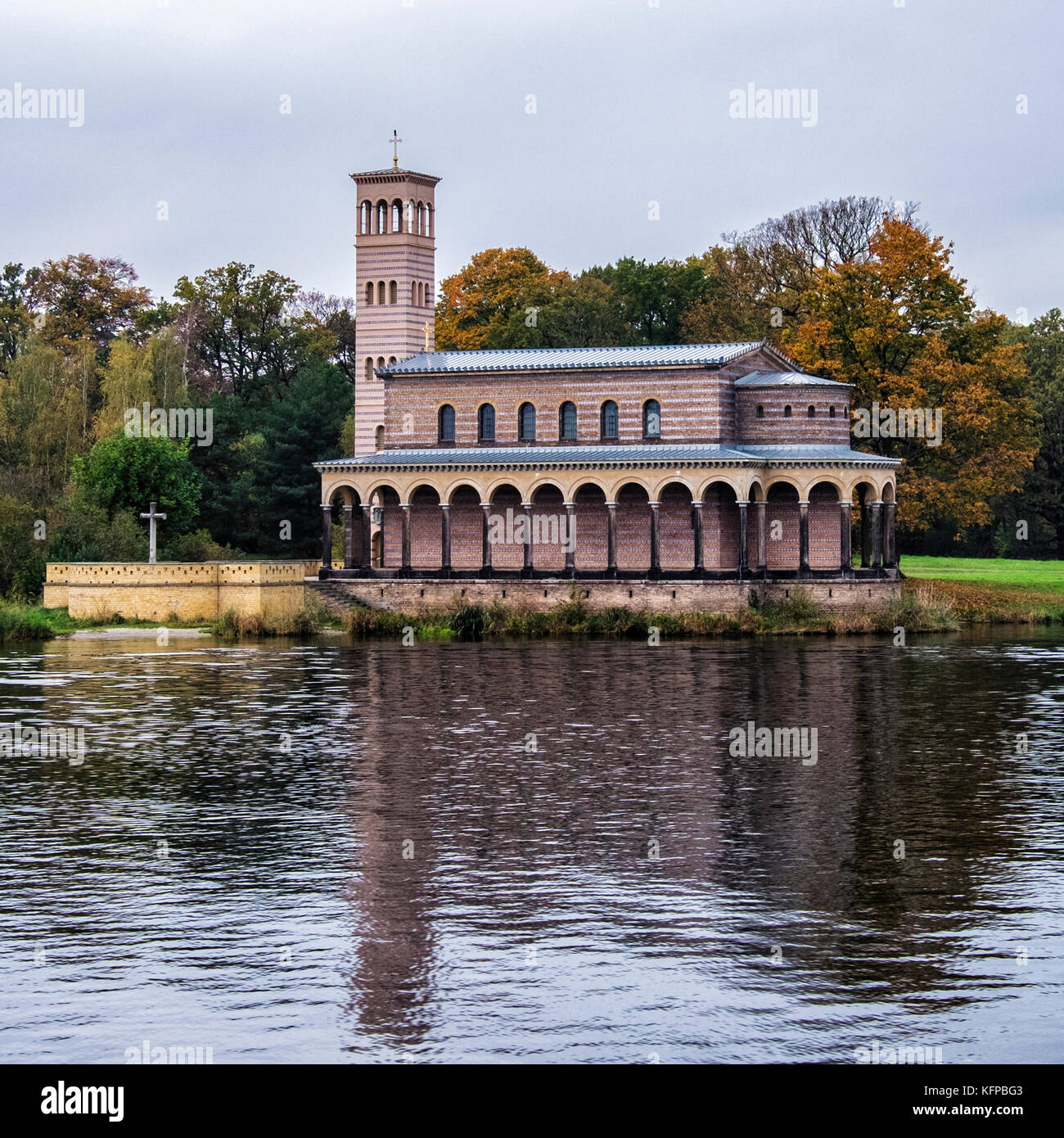 Sacrow,Potsdam.Protestant Church of the Redeemer next to Lake Jungfernsee.Decorative brick building Built 1844 in - Stock Image