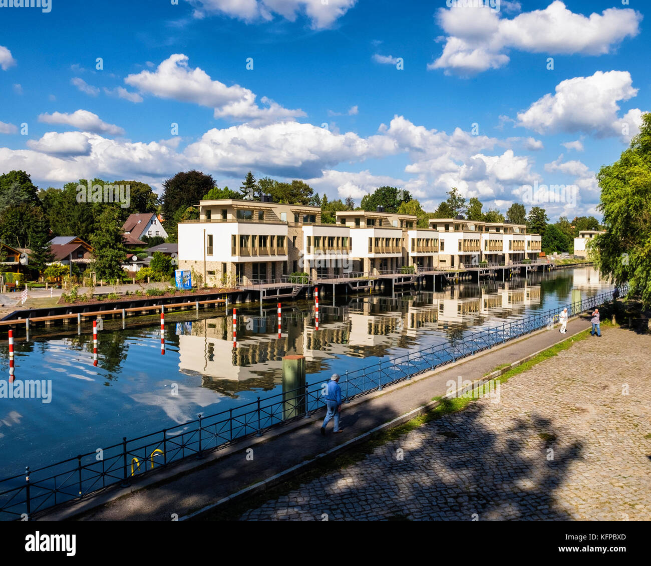 Berlin,Tegel lake,Tegeler see,Modern luxury new homes with roof terraces and boat mooring area on Humboldt island - Stock Image