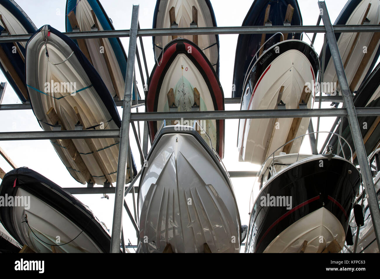 Boats stacked in storage at Camber Dock, Portsmouth - Stock Image
