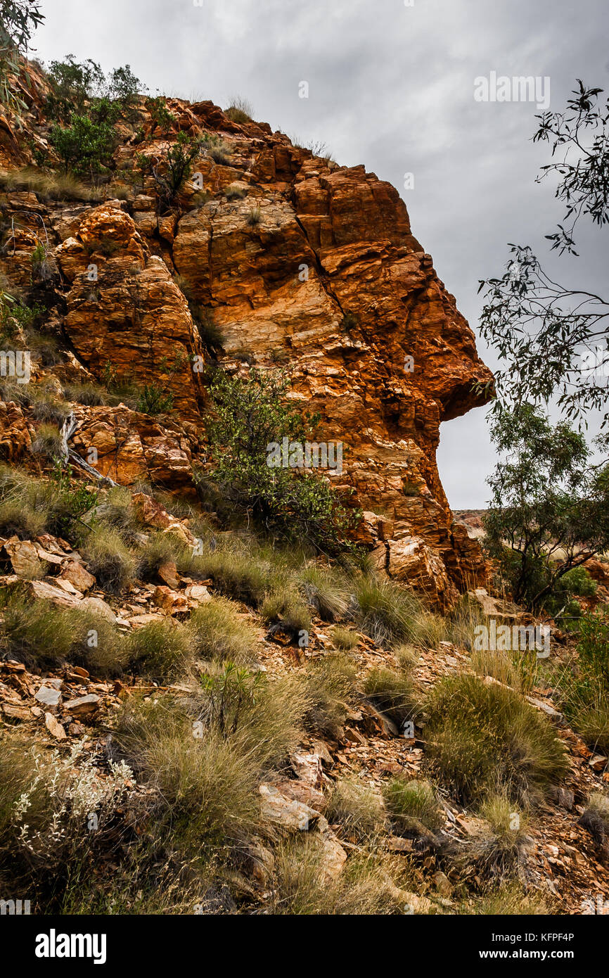 A face-like natural rock formation in Ormiston Gorge, West MacDonnell National Park, Australia - Stock Image