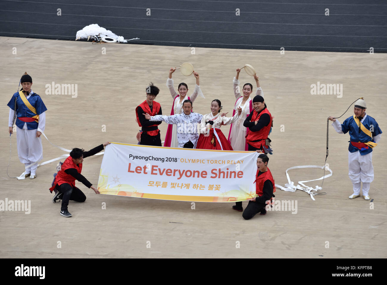 Athens, Greece, 31st October, 2017. Korean performers hold a banner during the handover ceremony of the Olympic - Stock Image