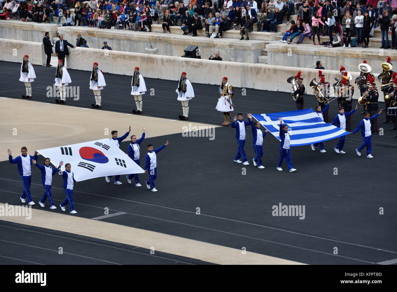 Athens, Greece, 31st October, 2017. Students carry the flags of South Korea and Greece during the handover ceremony - Stock Image