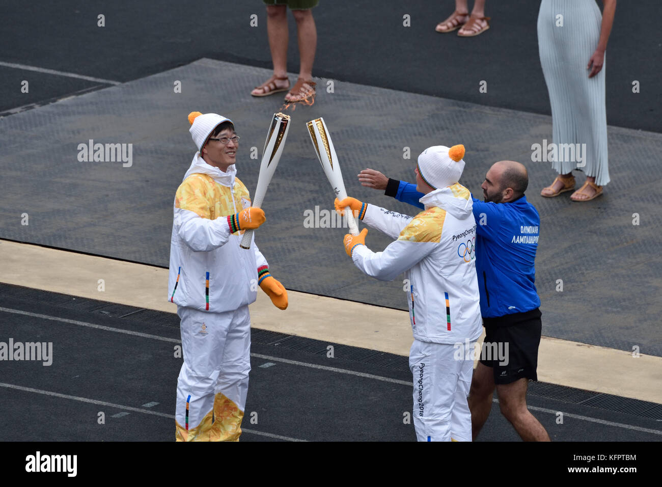 Athens, Greece, 31st October, 2017. The Korean retired speed skater Kim Ki-hoon (L)  hands over the Olympic Flame - Stock Image